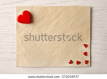 Blank present card with small hearts on wooden background #372018937