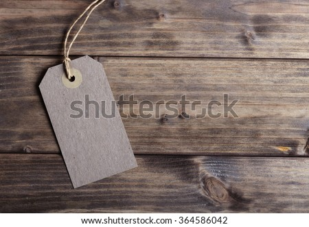 Blank price tag on the background of wooden planks #364586042