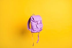 Blank purple stylish trendy backpack strap mockup flat lay view flight air over vivid shine background