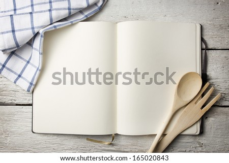 Blank recipe book on wooden table
