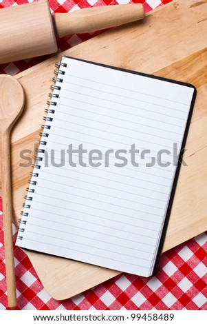 blank recipe book with wooden spoon