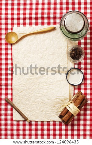 blank recipe card and spices on checkered napkin