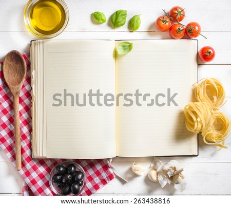 Blank recipe cooking book and ingredients on white table,selective focus and above