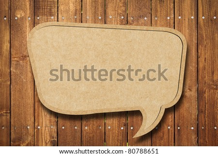 Blank Recycle paper Speech Bubble on wood background