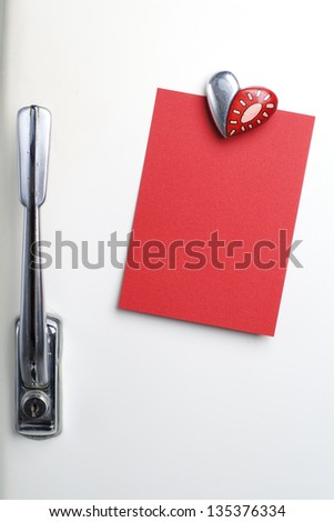 Blank red note on fifties fridge-door, heart shaped-magnet, copyspace