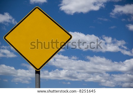 blank roadsign ready for text against a blue sky background