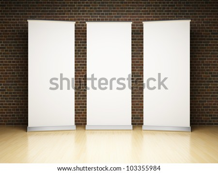 Blank roll up banner in studio on brick wall