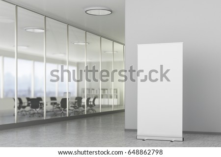 Blank roll up banner stand in bright office interior with clipping path around ad banner. 3d illustration