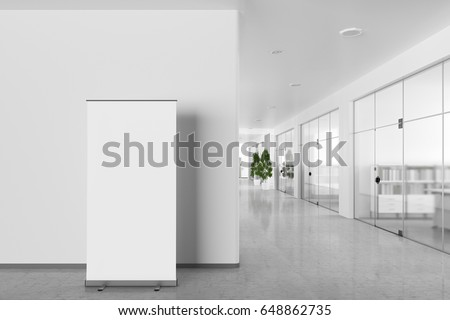 Blank roll up banner stand in bright office interior with clipping path around ad stand. 3d illustration