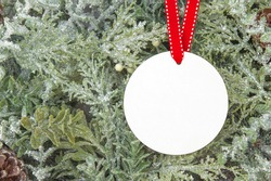 Blank Round Christmas Ornament Mockup over Christmas tree background