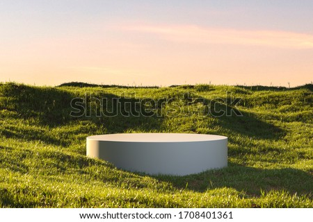 Blank Round White Showcase on Green Grass at Heaven Meadow. Copy Space. Empty Space. 3d rendering stock photo