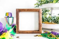 Blank rustic square wood sign with mardi gras decor, farmhouse style fleur de lis mockup