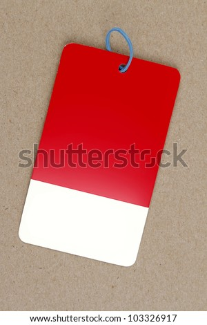 Blank sale tag on brown background