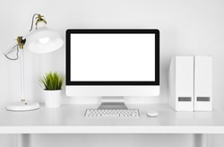 Blank screen computer, lamp and table folder over white background