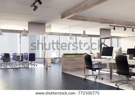 Blank screen computer on a wooden office desk in a room with panoramic windows. Side view. 3d rendering mock up