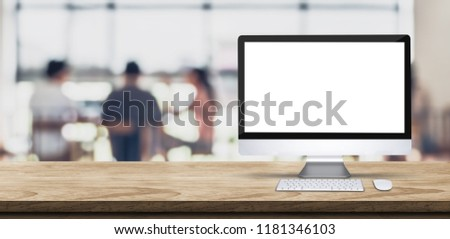 Blank screen desktop computer on wooden table top with blur people working at creative office bokeh background,Mock up for display or montage of design #1181346103