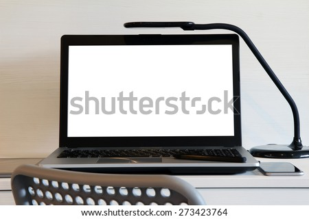 blank  screen laptop computer with table lamp is on wooden desk as workplace concept