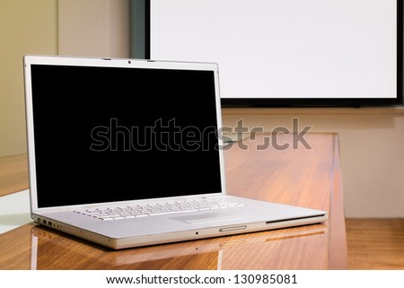 Blank screen laptop in conference room, meeting room, boardroom, Classroom, Office.
