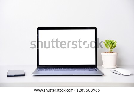 blank screen Modern laptop computer with mouse,Smart phone and Succulent on wood table in office view backgrounds #1289508985