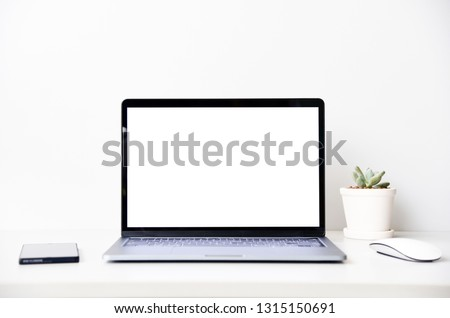 blank screen Modern laptop computer with mouse,Smart phone and Succulent on wood table in office view backgrounds