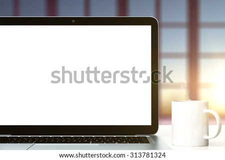Blank screen of laptop and cup of coffee, mock up