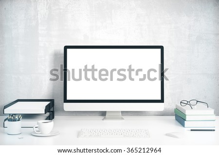 Blank screen on the desktop computer with books and cup of coffee, mock up 3D Render