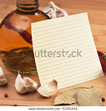 blank sheet for cooking recipes and spices on a wooden table