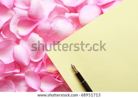 Blank sheet of paper for greeting or invitation lying on red rose petals background