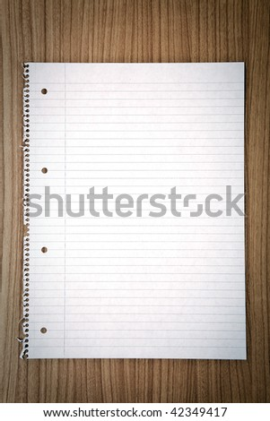 blank sheet of paper on table - stock photo