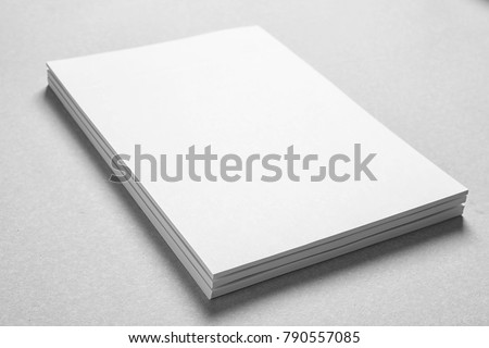 Blank sheets of paper on light background. Mock up for design #790557085