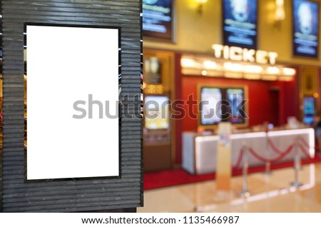 blank showcase billboard or advertising light box for your text message or media content with blurred image of ticket sales counter at movie theater, advertisement, marketing, entertainment concept