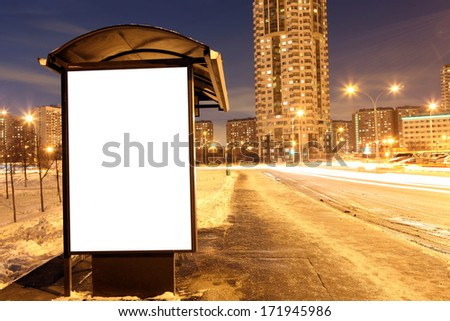 Blank sign at bus stop at evening in city