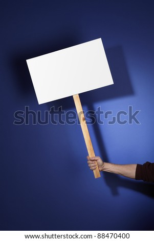 Blank sign held by hand and customizable with your message.