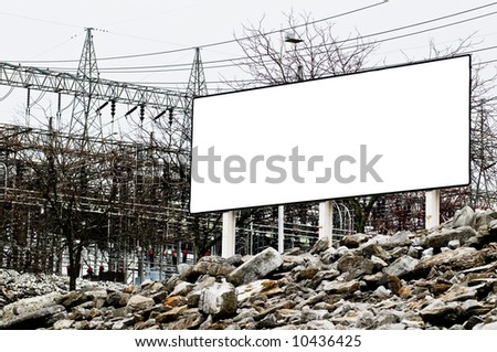 Blank Sign in front of power station great for warning or environmental awareness