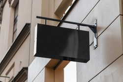 Blank sign mockup in the urban environment, on the facade, empty space to display your store sign or logo
