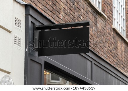 Blank sign mockup in the urban environment, on the facade, empty space to display your store sign or logo Photo stock ©
