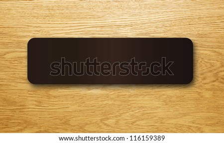 Blank sign on a wooden office door.