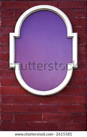 Blank sign on brick wall