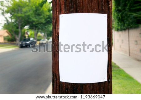 Blank sign posted on a pole