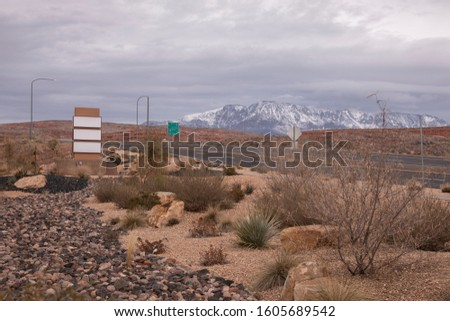 Blank Signboards on highway with snowy mountains