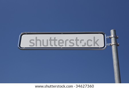 blank signpost, blue sky in the background