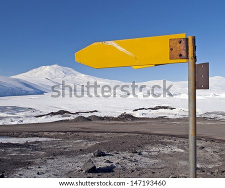 Blank signpost with Antarctic landscape in the background