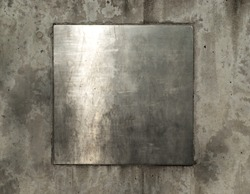 Blank silver metal plate on grungy wall