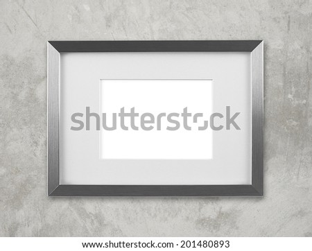 Blank silver picture frame on the wall