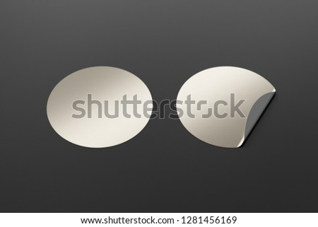 Blank silver round stickers straightened and with folded corner on black background. With clipping path around stickers. 3d illustration. #1281456169