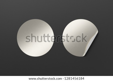 Blank silver round stickers straightened and with folded corner on black background. With clipping path around stickers. 3d illustration. #1281456184