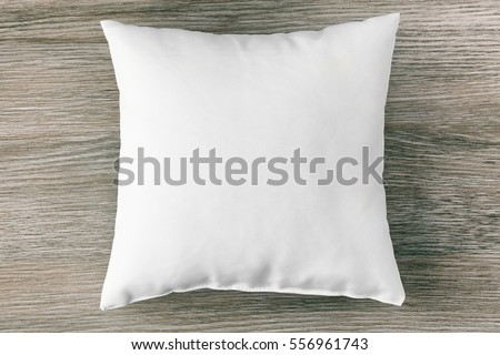 Blank soft pillow on wooden background