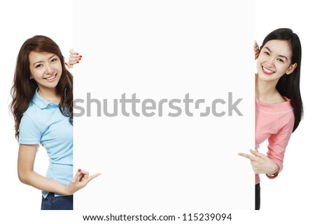 Blank space between two young women wearing casual clothes