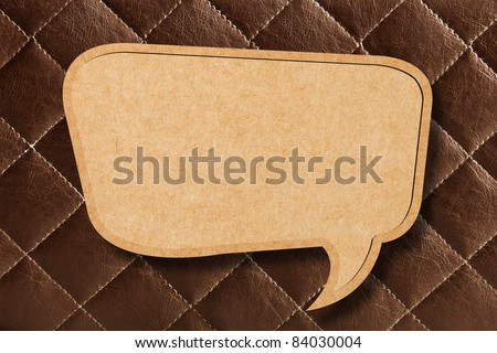 Blank Speech Bubble on Brown leather Background