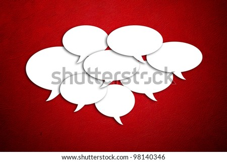 blank speech bubbles on the red wall background